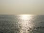 水平線に沈む夕日が反射した写真素材02