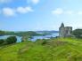 スコットランドの古城と海の写真素材