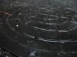 雨に塗れたマンホールの写真素材